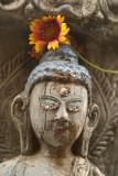 Close up of Buddha Statue with Flower at Kathesimbhu