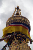 Man Replacing Prayer Flags in Boudha Stupa