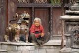 Old Lady Sat by Metal Fu