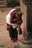 Old Woman Annointing Shrine Bhaktapur