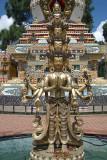 Statue in front of 1000 Buddha Stupa Detail Kopan Monastery