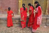 Women in Red Saris at Chobar Temple