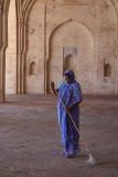 Woman in Purple Sweeping Ibrahim Rouza