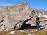 Steve holding up the boulder