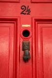 Hand Knocker on Red Door