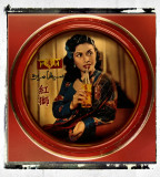Old tray with advertisement featuring actress Maria Menado