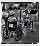He` s no longer able to walk but he`s all the more able to listen to her music...