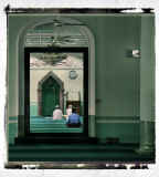 muslims praying in the male section of a mosque