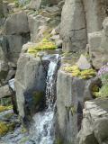 Water coming from inbetween the rocks