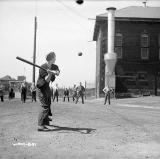 Workers play a game of baseball
