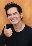 GUSTAVO SMILE HAND HAIR.jpg