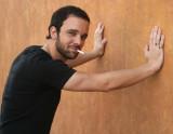 A HORIZ CIG ORANGE WALL HANDS.jpg