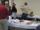 Jim Sapienza chats with another attendee