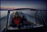 Madelene driving our boat in 30 knots on lake Helgasjön