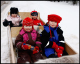 Happy Kaamanen children (towed by snow-mobile)