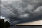 Thunderclouds passing lake Toftasjön north of Växjö
