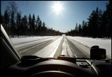 Driving south in Lapland - backlight and icy roads....