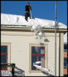 Taking down the snow from roofs in Hudiksvall