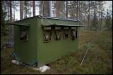 Forrest hide belonging to Boreal Wildlife Center. Double camouflage layers and tall roof ventilation for less smell....