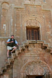 Jan-Michael Breider climbing the famous narrow stairs in Noravank