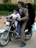Family on motorcykle - a common sight in Iran