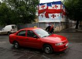 Cleening his taxi in Tbilisi