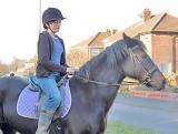 girlon horse.jpg