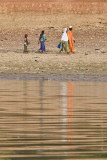 A Family Strolling on the Bani River Bank