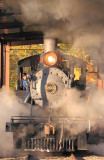 The 203 leaves the small riverseide engine house and heads out to the mainline