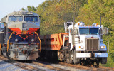 A NS Brandt truck with 3 empty air dump cars passes 61A as it waits for a Louisville cew at the wye.