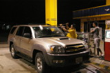 Getting Some Petrol and a Windshield Cleaning at a 24 Horas Station