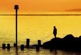 Sunset fishing, West Bay