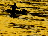Canoeing on gold, West Bay