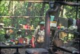 Rex Williams at his cabin and outdoor kitchen 1977
