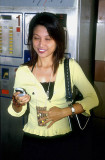 Commuter with her handphone'