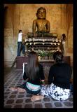 Applying Gold Leaf to Buddha