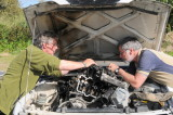 Ian and John Welsford wrestling with broken cylinder head