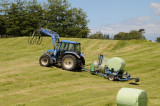 New Zealand farmers are busy harvesting grass for feed during the summer