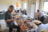 Ian making a mess carving wood in Karen's kitchen
