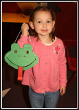 Noelle makes a frog mask in the craft center