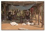 Women grinding sorghum