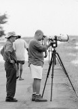 BIF SHOOTING AT CANDABA WETLANDS. Yours truly (the one with a featherless head) shoots a beta 7D + 800 f/5.6 IS at birds in flight, as Ely T. (a friend and fellow birdshooter who owns the 800 5.6L) looks on.  [Photo by Ralf Nabong using a Leica R8]