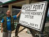 HIGHEST PHILIPPINE HIGHWAY. As the banged up sign says, this portion of the Halsema Highway at Atok, Benguet Province  is the highest point (Elev. 2256 m/7400 feet) of the Philippine Highway System. This is where I stop and calibrate my altimeter.   [350D + Sigma 10-20]