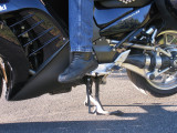Feet on pegs from left side
