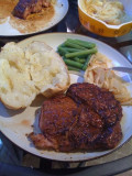 Chili-lime Rib Eye with baked potato, green beans, and saute onions