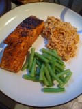 Salmon filets with Northwest spice rub, sundried-tomato basil rice, and steamed green beans