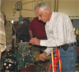 (153)   Larry Smith makes some adjustments to his Fairbanks Morse 3 cylinder