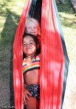 Peas in a pod-two young ones comfortably nestled in a hammock