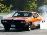 At the drag track  heating up the tires
