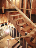 Stairs to basement and second floor are in place